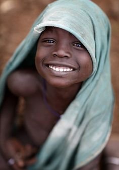 souls-of-my-shoes:  Ethiopian tribes, happy Mursi boy (by Dietmar Temps)