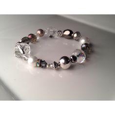Bracelet de perles de verre, cristaux et billes de métal plaqué. Bracelet with glass beads, crystals and beads plated metal.