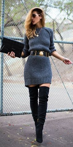 Shop this look on Lookastic: https://lookastic.com/women/looks/sweater-dress-over-the-knee-boots-clutch-waist-belt-sunglasses-pendant/8807 — Black Suede Over The Knee Boots — Charcoal Knit Sweater Dress — Black Leather Waist Belt — Black Leather Clutch — Gold Pendant — Gold Sunglasses