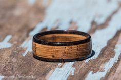 Tennessee Whiskey Barrel and Ebony Wood Ring - Whiskey Barrel Ring Mens Wedding Band Womens Wooden Wedding Engagement Ring Wood Anniversary by HawkinsHandicrafts on Etsy https://www.etsy.com/ca/listing/280514630/tennessee-whiskey-barrel-and-ebony-wood