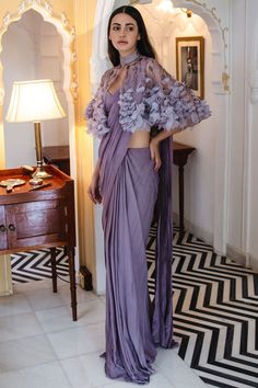 Shop Gaurav Gupta Draped Saree Gown with Cape , Exclusive Indian Designer Latest Collections Available at Aza Fashions Stylish Blouse Design, Fancy Blouse Designs, Stylish Dress Designs, Indian Fashion Dresses, Indian Designer Outfits, Stylish Sarees, Stylish Dresses, Stylish Gown, Saree Blouse Patterns