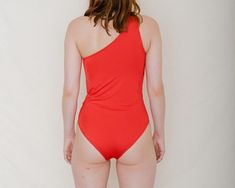 One shoulder swimsuit. Soft and shiny stretchy fabric. Kamm Pants, Red Leotard, Norse Goddess, One Shoulder Swimsuit, Text On Photo, Easy Wear, Swimsuits, Swimwear, Sun Protection