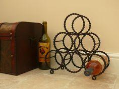 Reclaimed bicycle chain wine rack.