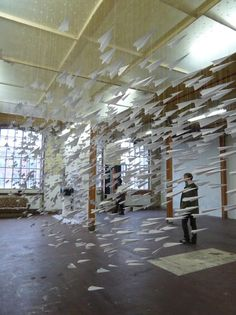"""New work from Berlin-based artist Astrid Bin, described as """"one thousand paper airplanes are suspended in flight, like flocking birds, or swarming insects."""""""