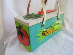 50s 60s Enid Collin Vegetable Box Purse, Painted Wood with Leather Handles & Mirror. $100.00, via Etsy.