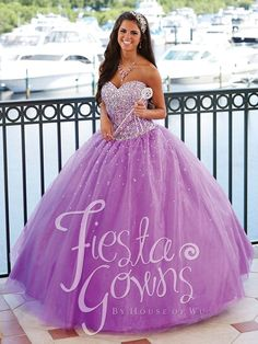For the true princess, this ballgown silhouette strapless dress is just like something out of a storybook. A dense scattering of rhinestones falls in an ombre array from the sweetheart neckline to the dropped basque waistline...