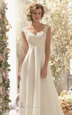 Imagine the radiant bride you will be in Voyage by Mori Lee 6778. This flowing empire wedding gown is made of Alencon lace and chiffon. The fitted bodice features a V neckline with wide straps and v shape back. It comes with a detachable back cowl.