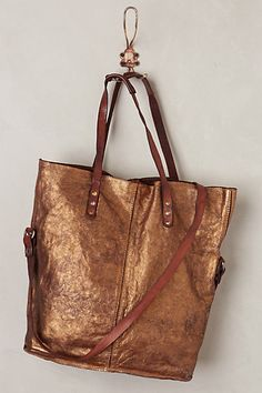 Aurora Tote - anthropologie.com - something like this with that piece of leather?  Stencil gold?
