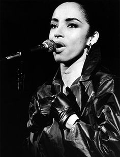 SADE ADU ~ Born: Jan 16, 1959 in Ibadan, Nigeria. Singer-songwriter, composer & record producer. She first achieved success in the 1980s as the frontwoman & lead vocalist of the Brit & Grammy Award-winning English group Sade. In 2002, she received an OBE from Prince Charles for services to music. In 2012, Sade was listed at number 30 on VH1's 100 Greatest Women In Music. She is the most successful solo female artist in British history, having sold over 110 million albums worldwide.