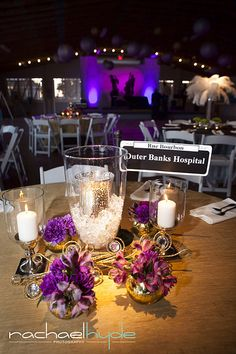 Vintage New Orleans Mardi Gras gala.  Stage lighting.  Jazz silhouettes.  Black, gold and purple.  Street sign table names.  Table decor.  Lanterns.  Design by Amy Hilliker Klebitz - certified interior designer: amyklebitz.com   Photo from Children at Play collection by Rachael Hyde Photography