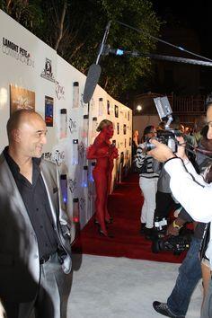 Omar Akram getting interviewed