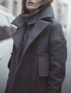 The cut of grey coat, big patch pocket, and thick and textured turtle neck sweater... cozy yet chic