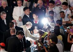 Pope Francis blesses a devotee at Mall of Asia Arena in Manila, Philippines Pope Francis blesses a devotee at Mall of Asia Arena in Manila, Philippines, during his visit to the country which is home to 80 million Catholics.