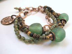 African Recycled Glass from Happy Mango Beads sandwiched between Antiqued Copper Bead Caps as the focal, then complimented them with Green Czech Glass Beads, Copper Chain and Navajo Turquoise Picasso Mixed Czech Glass Seed Beads.  Find this piece on Etsy here: http://www.etsy.com/listing/122950118/recycled-glass-copper-and-picasso-czech