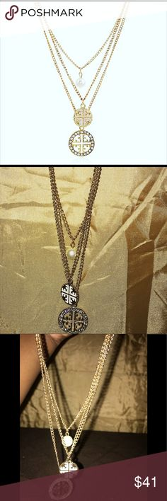 5e341d6ddea Shop Women s Tory Burch Gold White size OS Necklaces at a discounted price  at Poshmark. Description  Dimensions Sz 42 It s gold white and pearls!