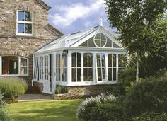 This traditional conservatory was designed, handmade and installed by The Caulfield Company. Built in their Yorkshire workshops in solid Sapele hardwood with maintenance free cappings, it is painted in a soft white finish which perfectly suits the well-established garden caulfieldcompany.co.uk