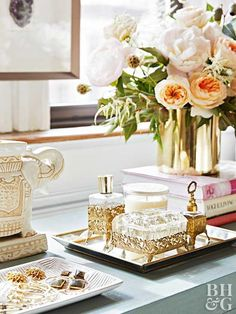 A shallow tray is the perfect place to display perfume and lotion bottles for easy access.