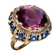 Amethyst sapphire and diamond ring in yellow gold.