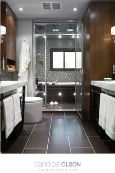 Mix of warm wood cabinetry with cool tile flooring and shower is a bathroom marriage made in heaven! Built in Rain Shower • Soaker Tub • Mosaic Tile • Sconce Lighting for the Vanity •#candiceolson #candiceolsondesign Candice Olson, Soaker Tub, Rain Shower, Sconce Lighting, Mosaic Tiles, Creative Design, Sconces, Sweet Home, Bathtub
