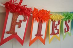 This super fun and festive Fiesta Banner is the perfect touch for your fiesta! :)  Fiesta is hand glittered in a cherry red glitter. The letters sit atop a white card stock with different festive colors as the bottom layer (red, orange, yellow, bright green, aqua, hot pink). Coordinating tissue fringe is at the top of the banner for an extra festive touch. So fun!  You will receive one Fiesta banner.  **** Please note size of banner ****  The banner is appx .30 long. Each flag of the banner…