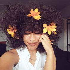 Would You Rock It? The 'Floral Fro' Is A Trend That's Here To Stay  Read the article here - http://www.blackhairinformation.com/general-articles/opinion/general-opinion/rock-floral-fro-trend-thats-stay/
