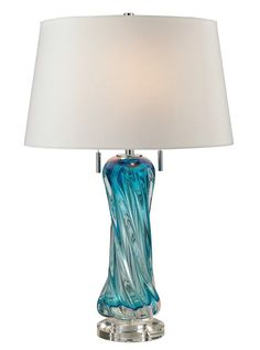 Using centuries old techniques first employed by the artisans of Murano, this 24 inch tall free form Blown Glass Table Lamp in Turquoise Sea Blue is finished with a double pull chain switch and gorgeous deep turquoise blue faux silk shade.