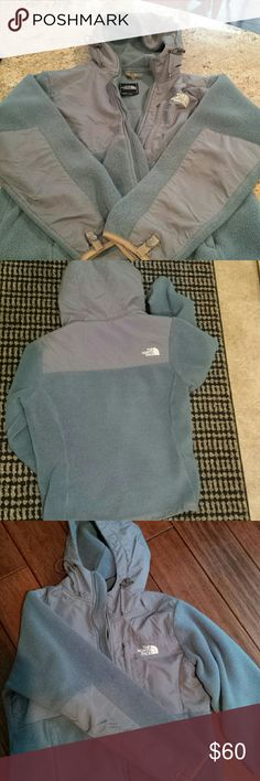 North face Denali hooded jacket Super thick and warm in a unquine sea blue color. Two small holes on inner sides of pockets as shown in picture, not noticeable when wearing. No other rips, tears or stains, jacket still in great condition! North Face Sweaters