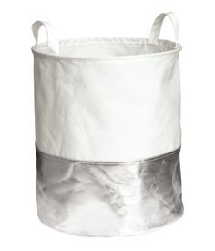 Laundry bag in thick polyester with a shiny metallic lower section and two handles at top. Plastic coating inside. Size 14 1/2 x 17 3/4 in.