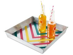 Wipe down the tray with rubbing alcohol and a cloth. Use a triangular ruler (a.k.a. a set square) and painter's tape to block out a zigzag design. To ensure the paint will stick, scuff up the exposed metal lightly with sandpaper, then wipe clean. Apply primer made for metal and let dry. Paint, let dry, then slowly peel off the tape.  PAINT COLORS: Yellow Raincoat, Razzle Dazzle, and Tropical Turquoise by Benjamin Moore