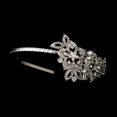 """This stunning antique silver clear crystal side accented flower bridal headpiece features a lovely antique silver plated floral design adorned with sparkling clear crystals. This side accented bridal headband will look fabulous on any classic, modern or vintage inspired bride with a white or ivory gown.  2"""" tall with design extending 4.5"""" on a 14"""" band"""