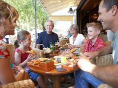 The next time you go out to dinner, have the check come to your child. Show him/her the bill. Discuss what each person owes at the table if you were to split the check. Teach him/her how a tip works. Help him/her calculate the tip. Let him/her look in your wallet for the correct change and discuss how much to expect back. This will help him/her understand how to apply the math lessons he's/she's learning in school to real-world situations.