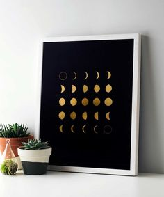 Moon phases gold foil art print with white frame. By Swell Made Co.