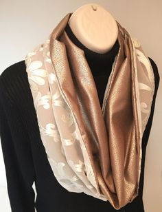 Check out this luxurious cream & gold sheer & microsuede reversible infinity scarf in The Bluebird Workshop. https://www.etsy.com/listing/217292230/metallic-gold-cowl-infinity-scarf