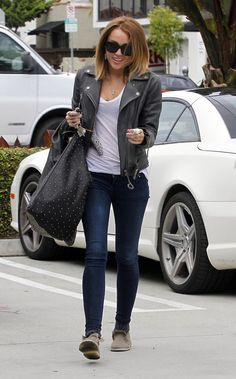 Nothing better than a simply white tee, leather biker jacket and denim, Miley Cyrus. #Celebrity #Style