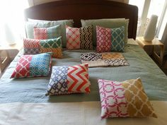 Here are all of the cushion covers that I made using one fabric sample book (free).