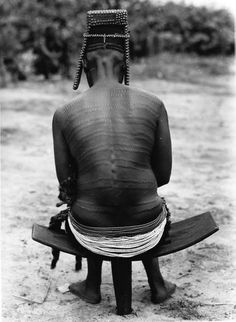 Africa | Bakutu woman.  Boende, Tshuapa District, Equateur Province, Belgian Congo. ca. 1940/50s | Scanned vintage photographic print; photographer C. Lamote