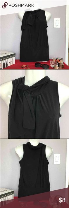 Black sleeveless top Has a 'built-in' scarf. Goes well with anything - any color trousers or jeans, cardigan, etc. Tops Blouses