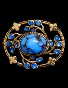 An Arts and Crafts gold, turquoise, enamel and gold brooch, by Jessie M. King for Liberty & Co., British, circa 1900. Signed Liberty & Co.