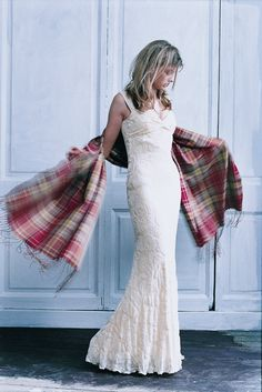ANTA Tartan Silk Scarf Scarf worn over a floor length white dress. To see more of ANTA's Fashion Classics go to – http://anta.co.uk/made-in-scotland/fashion-classics