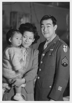 T/4 Taniguchi visits his wife and daughter at the Minidoka Relocation Center before returning to his unit in the Pacific. Taniguchi volunteered for the Army in 1942 when he and his family were at Tule Lake before it became a segregation center.