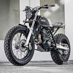 "bike-exif: looks like a bundle of fun, doesn't it? According to builders Kyle Scott and Chris Clokie, ""The idea was to produce a stripped down, street-legal custom bike inspired by the flat track racing scene."" The rider is a lady new to the motorcycling world, and we reckon it's the perfect first-time custom. See more fantastic @mickeymech images in high res at http://www.bikeexif.com/wolf-yamaha-tw200 #yamaha #tw200 #tracker #custommotorcycle #bikelife #bikeexif"