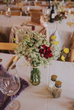 Jar Flowers Table Decor Centrepeice Red Yellow Whimsical Bright Village Hall Wedding http://www.beckyryanphotography.co.uk/