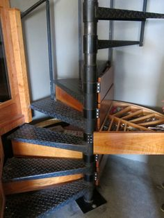 How Manhattan Artist Christopher Russell Created a Cabin in the Sky: storage drawers in the spiral staircase.