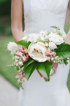 white and pink snapdragon bouquet with a magnolia by Resplendent