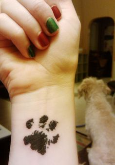 paw print - I would have loved to get a tattoo of my old dog's pawprint... wish I had a stamp of her pawprint somewhere...