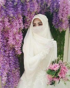 A woman wearing a beautiful niqab on her wedding day. Dressing modestly doesn't mean you can't dress beautifully!  (@setrinur)
