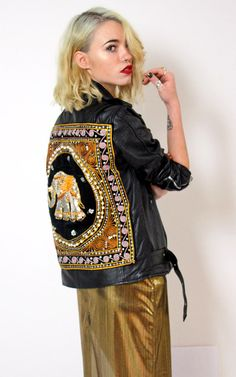 We love our Rebel Rebel elephant jacket. Fitted leather biker style jacket with belt detail, zipper pockets and shoulder poppers, featuring an intricately detailed sequin elephant motif on the rear.