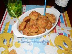 Polpettine di zucchine e prosciutto, sono ottime per un'antipasto appetitoso o un contorno sfizioso. Si preparano velocemente.