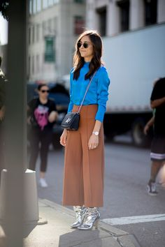 Love this unexpected combo of silver platinum boots and rust culottes / The Best Street Style from New York Fashion Week Street Style Spring 2018 Day 8, The Best Street Style from New York Spring 2018 shows at TheImpression.com