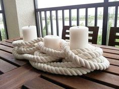 Very cool nautical centerpiece idea with candles and rope. Could definitely see us making this with Candle Impressions Flameless Candles! Wonder where one can find that kind of rope. Nautical Bridal Showers, Nautical Wedding Theme, Nautical Party, Nautical Food, Anchor Wedding, Nautical Centerpiece, Candle Centerpieces, Home And Deco, Beach Themes
